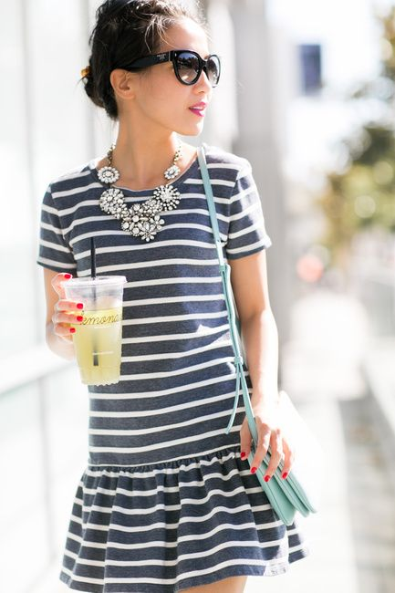 Striped dress, pastel bag and embellished statement necklace
